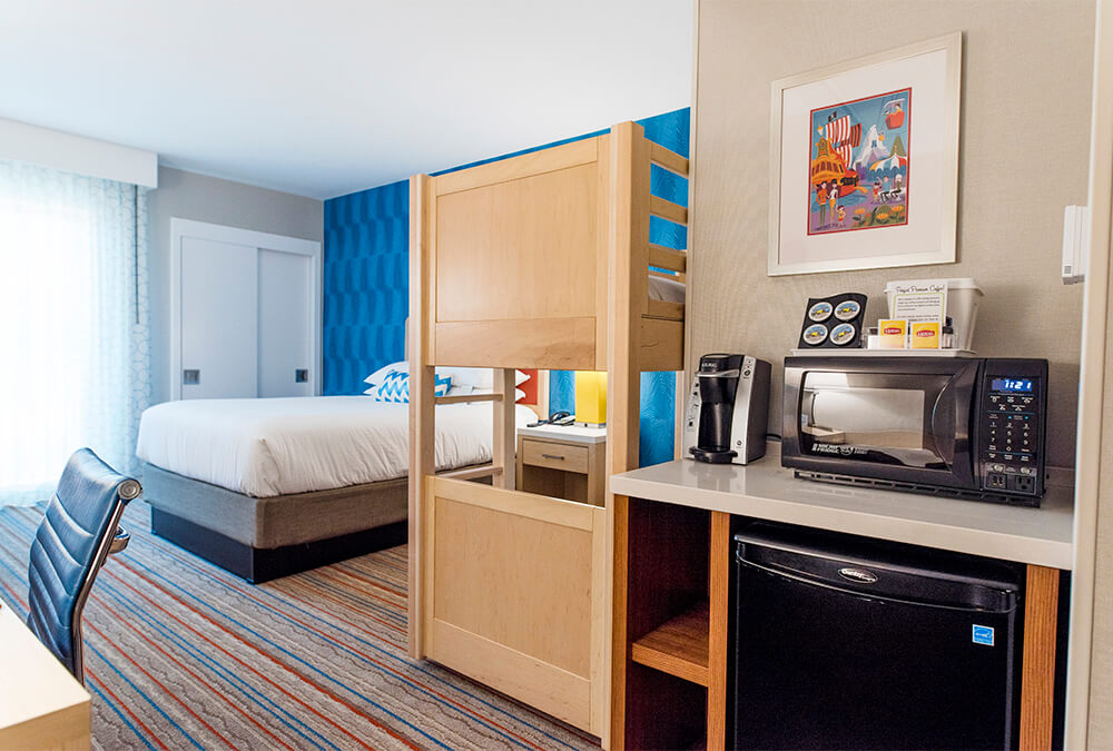 hotel room and kitchenette at Howard Johnson Anaheim Hotel