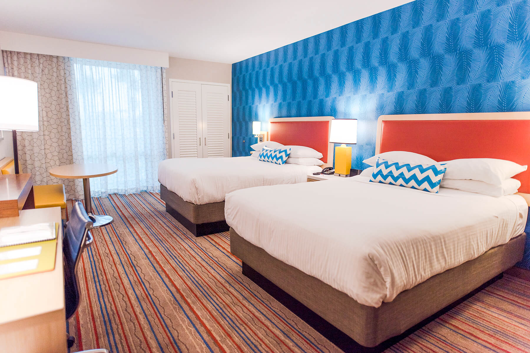 a hotel room at Howard Johnson Anaheim with two beds