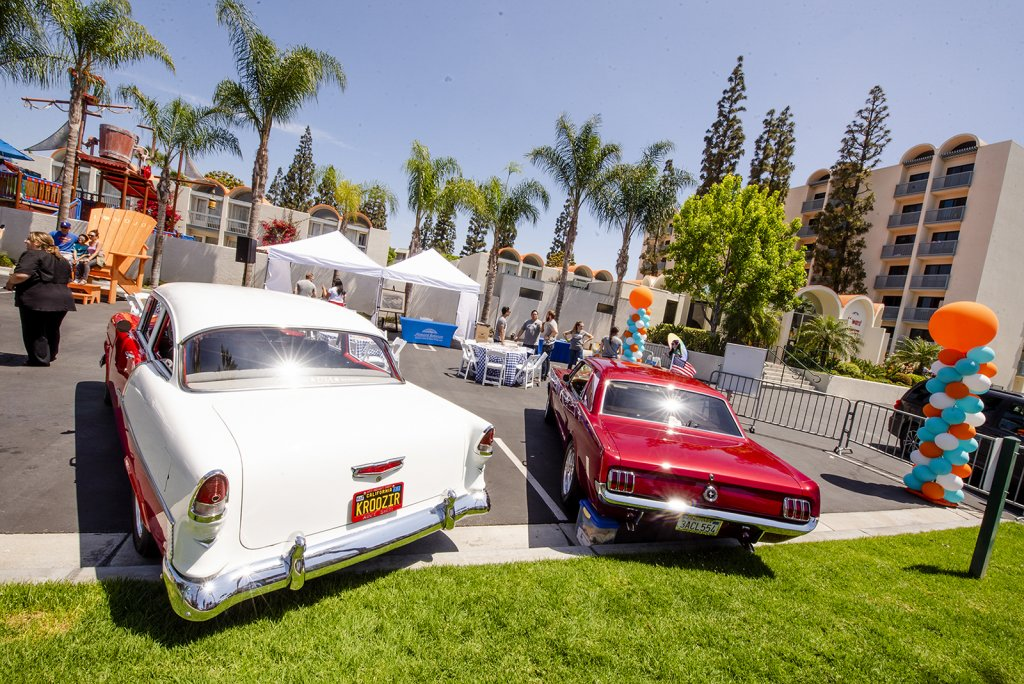 guests and retro cars at the retro unveiling event at Howard Johnson Anaheim