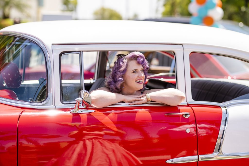 one of Howard Johnson Anaheim's retro friends poses in a retro car