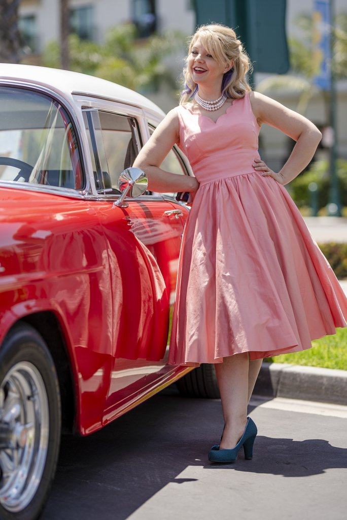 one of Howard Johnson Anaheim's retro friends poses near a retro car