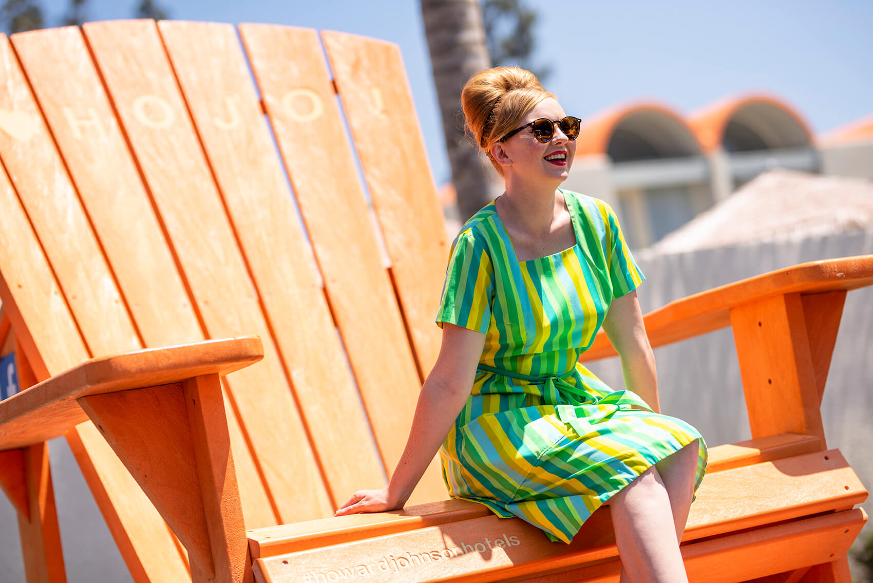 one of Howard Johnson Anaheim's retro friends poses on the large orange beach chair