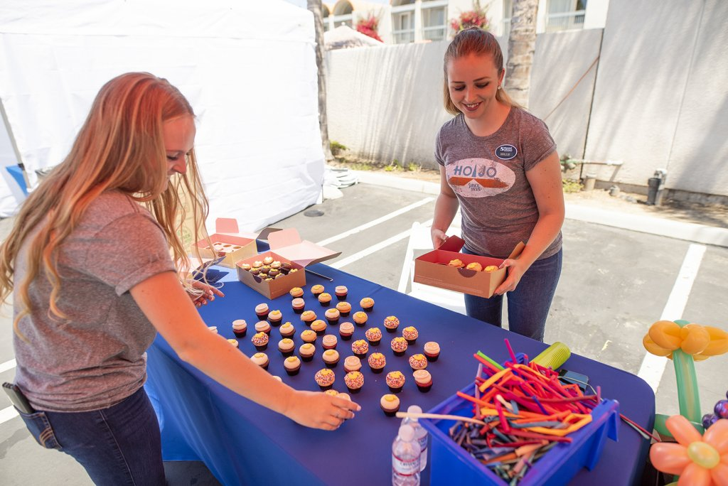 Howard Johnson staff sets up treats for event guests