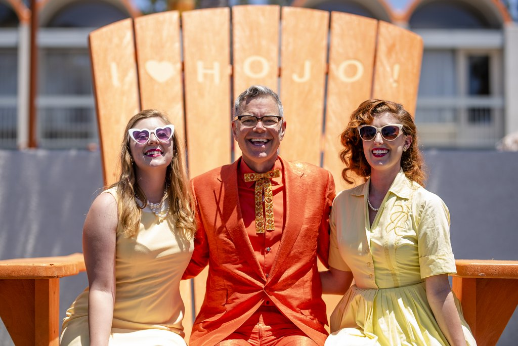 pop culture historian, Charles Phoenix, poses with HoJo Anaheim's retro friends