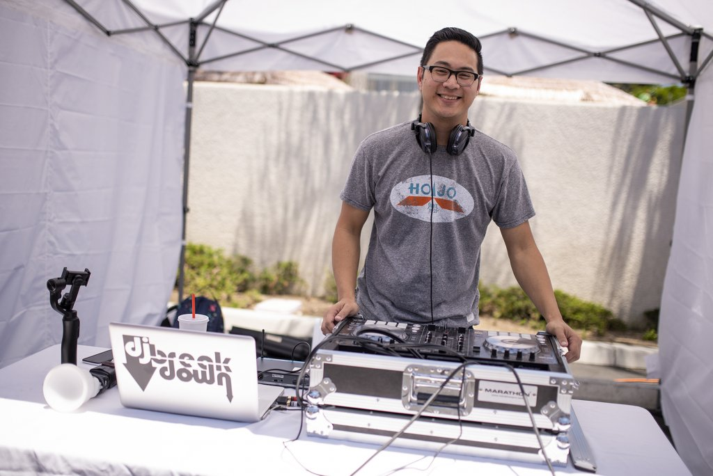 A dj spins tunes for guests at the Howard Johnson Anaheim retro unveiling event