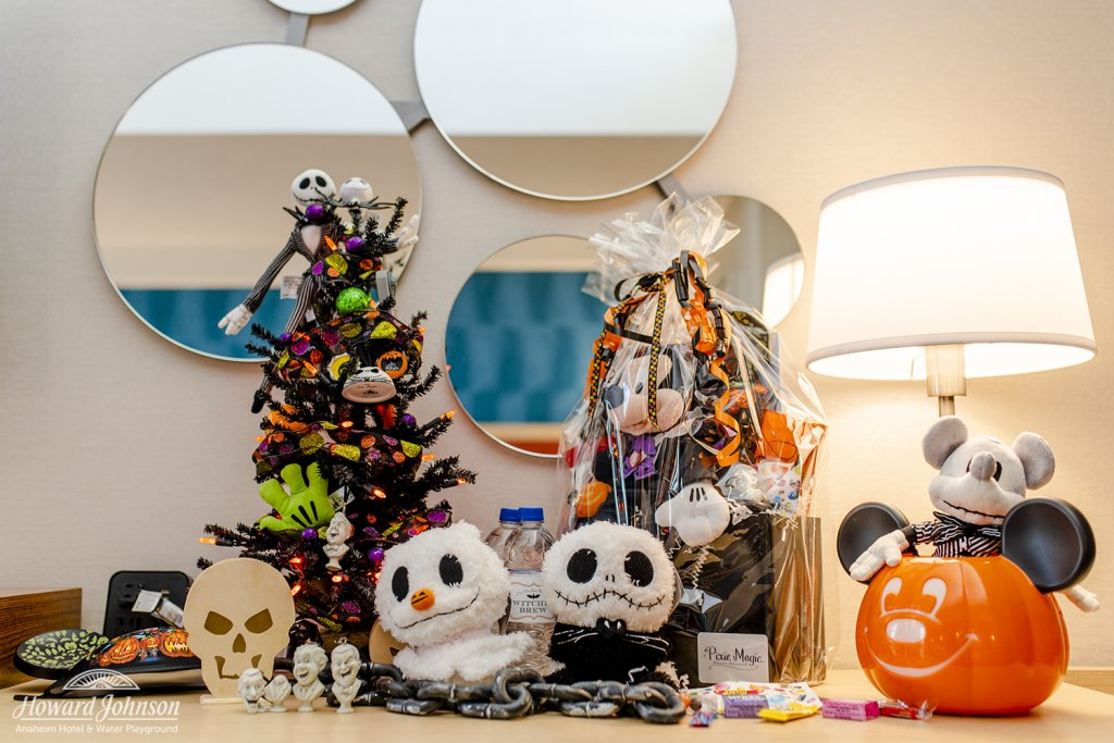 Halloween Disney decor and accessories pictured on a table