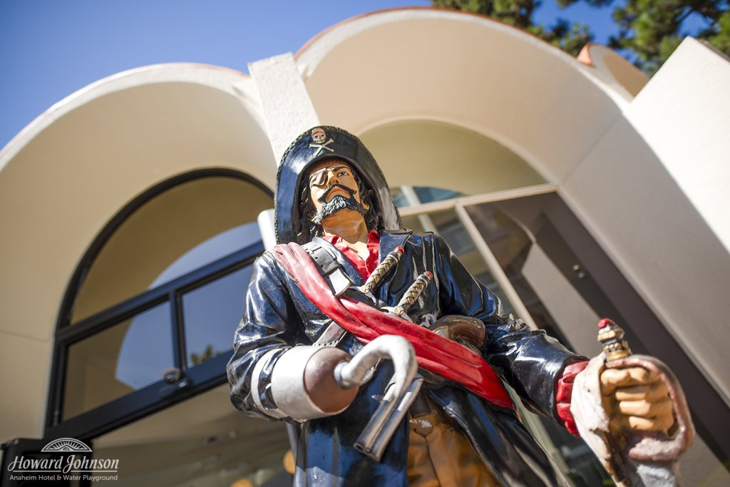 a statue of a pirate in front of Howard Johnson Anaheim