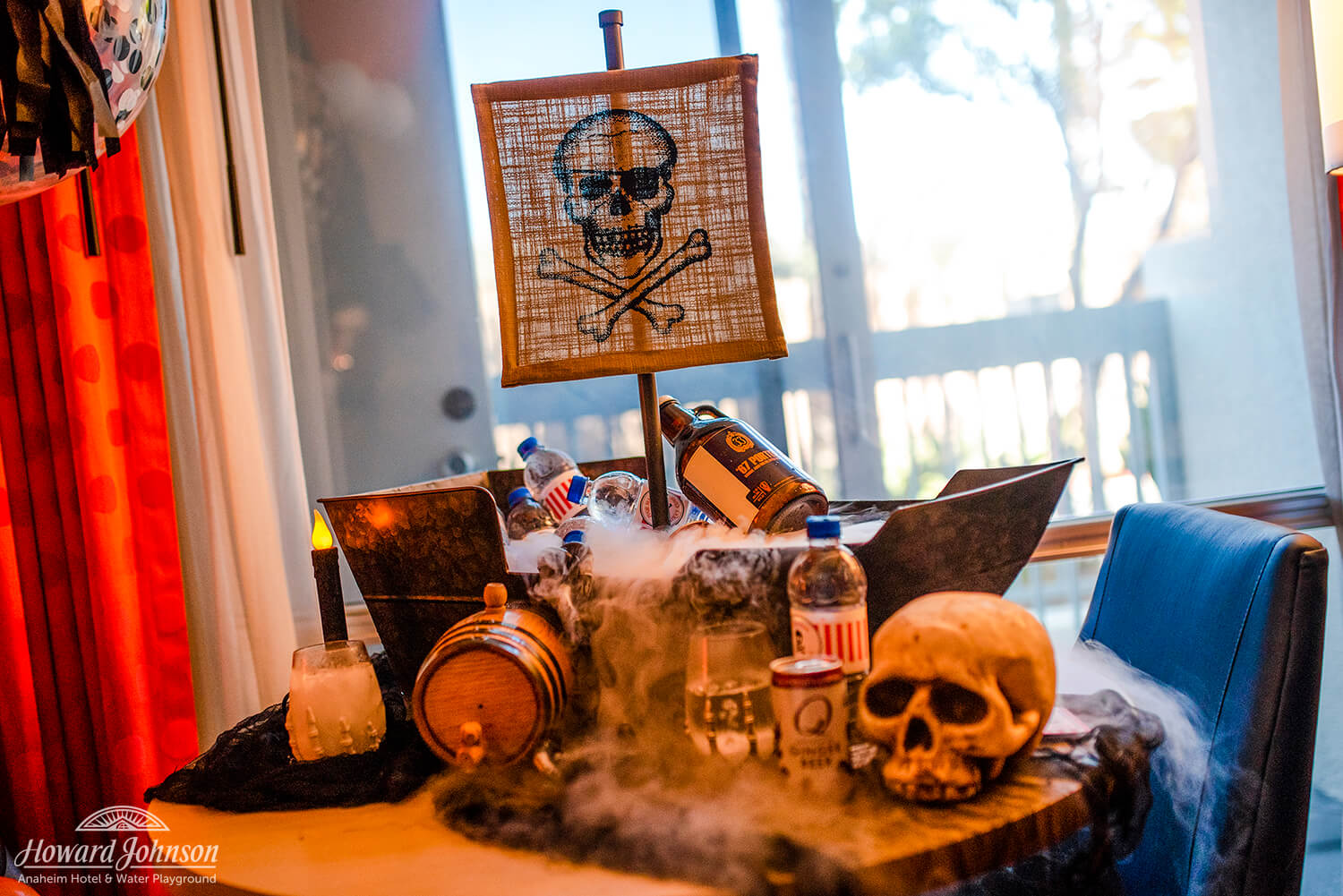 a pirate themed display features beverages on a table