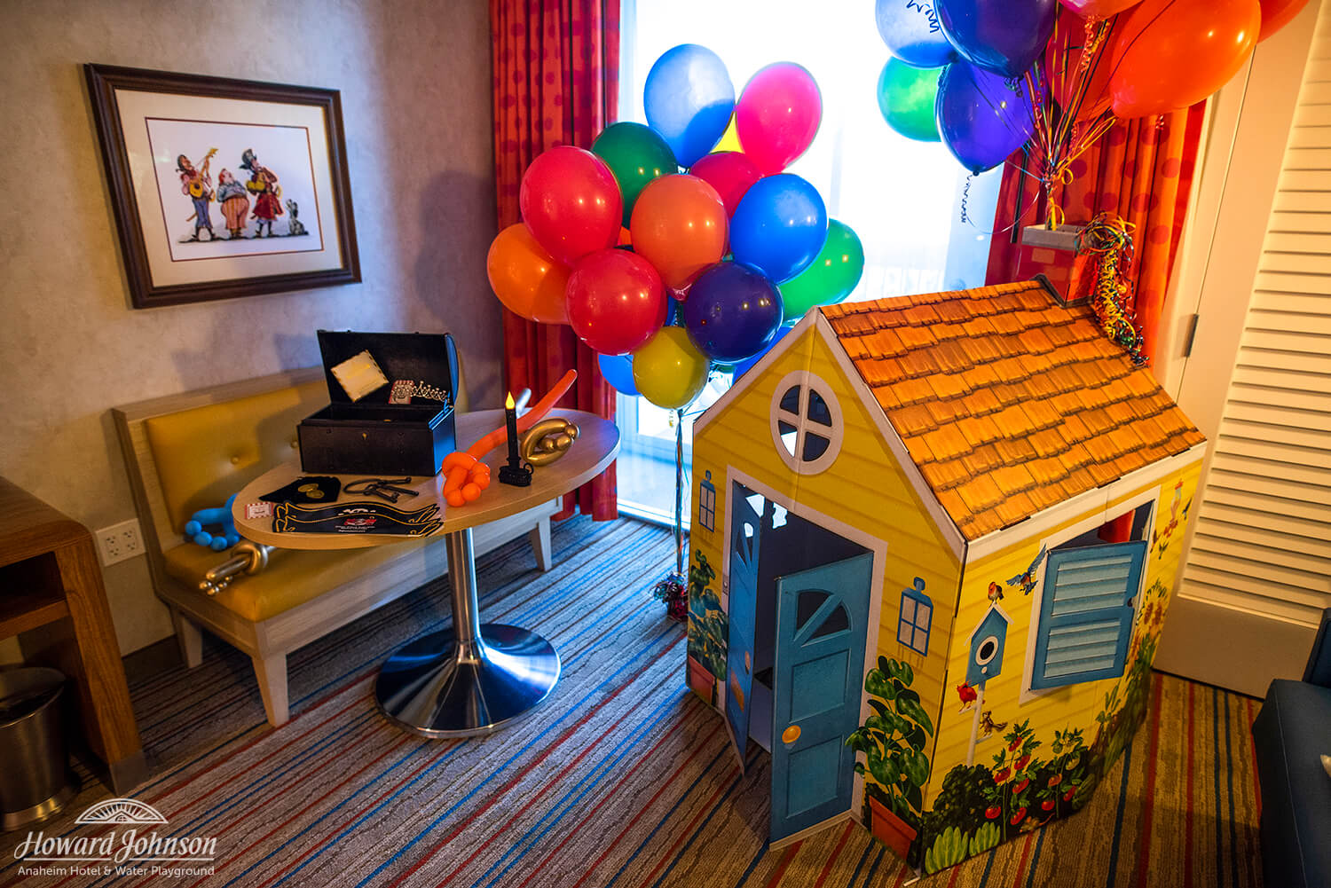 an UP movie themed hotel room features balloons and a cardboard house