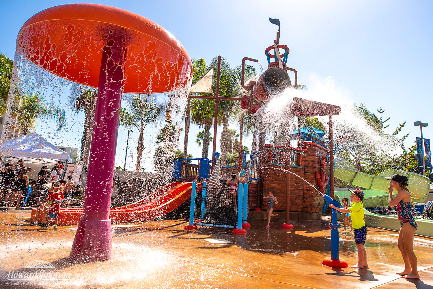 a wide shot of children playing at the Castaway Cove water park