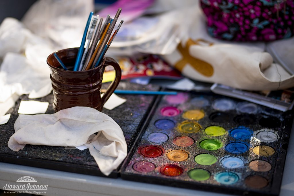 face paints and brushes on a table