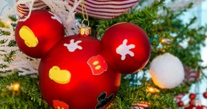 a Mickey Mouse themed ornament on a Christmas tree