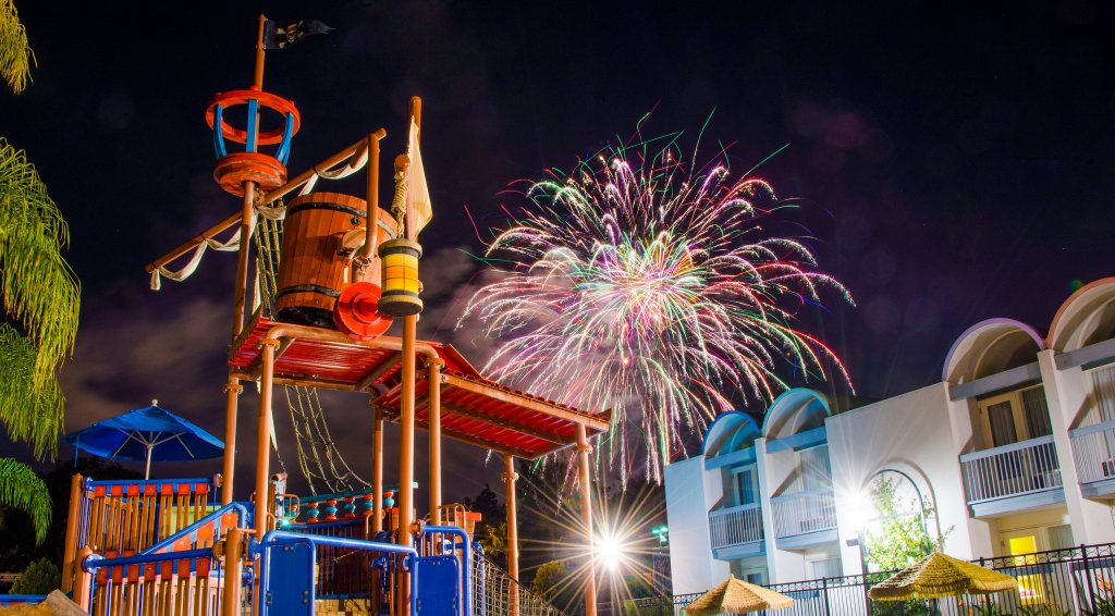 fireworks explode over the water park at Howard Johnson Anaheim