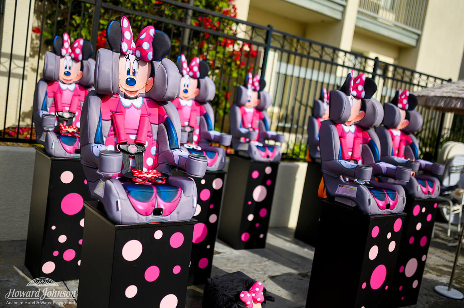 Minnie Mouse car seats are displayed on polka dot stands