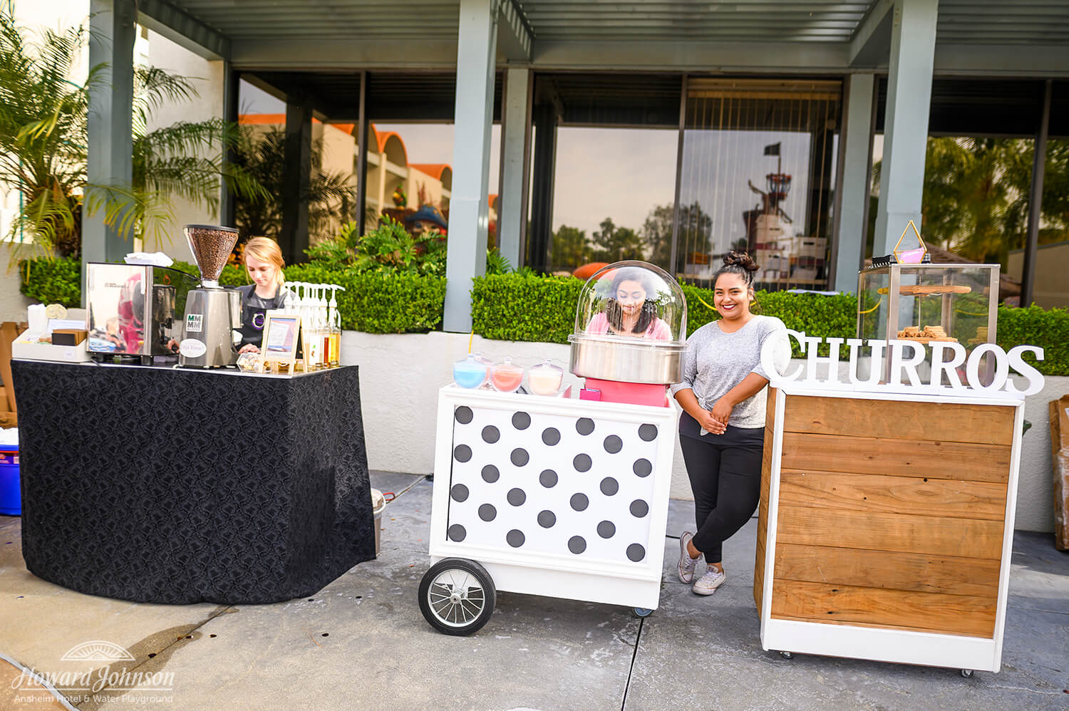 three food concession booths pictured outside Howard Johnson Anaheim hotel for beverages, cotton candy and churros