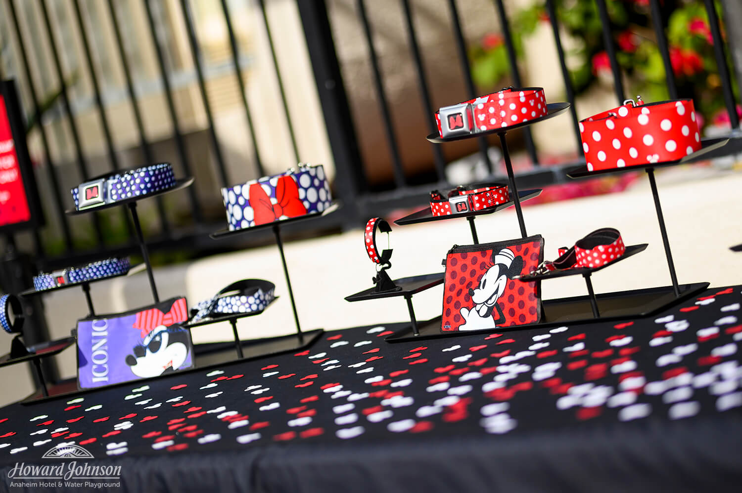 a plethora of Minnie Mouse accessories are displayed on a table with confetti