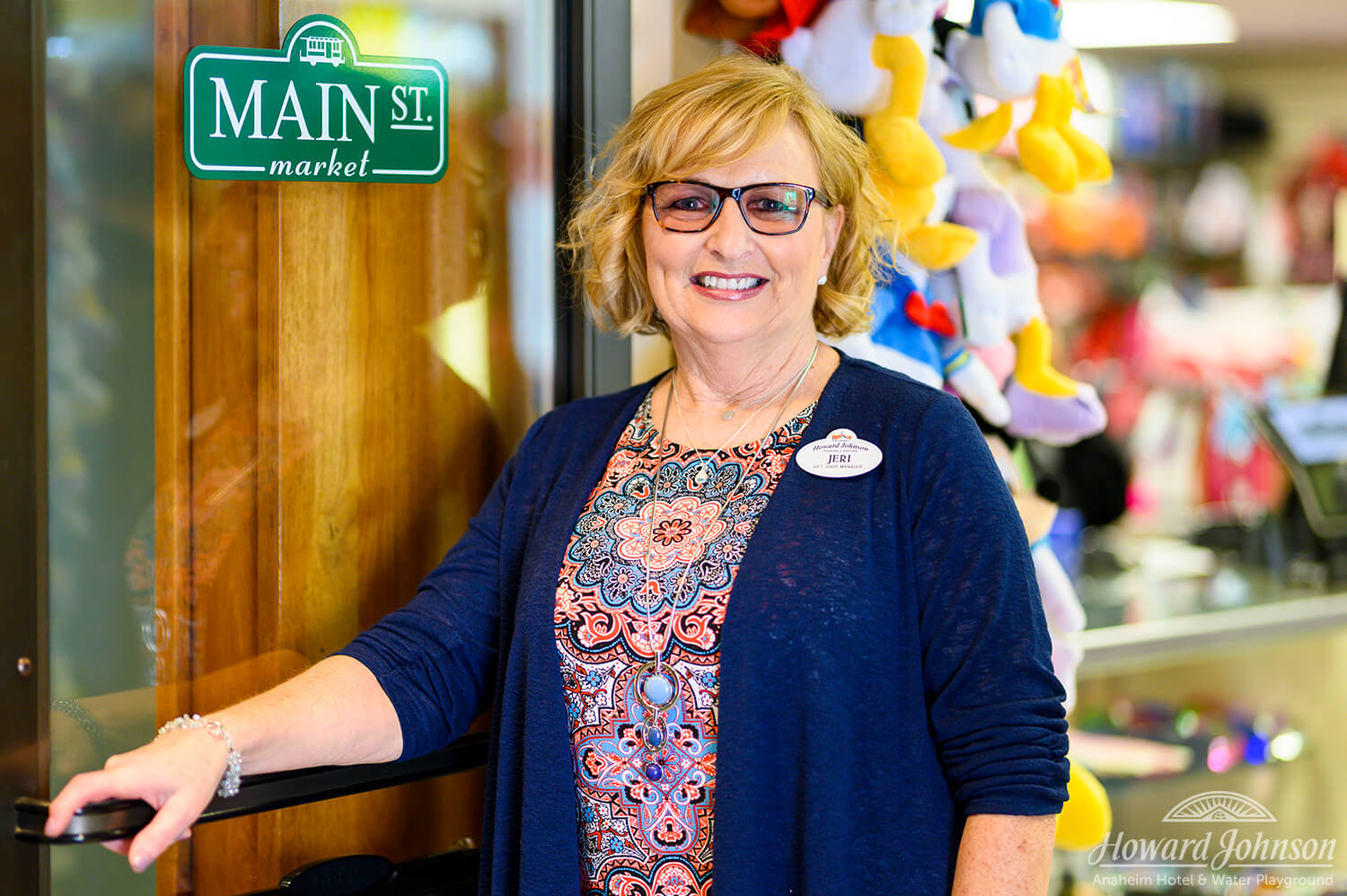 A Howard Johnson Anaheim employee named Jeri poses outside the Main St. Market